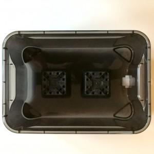 Abstandshalter in die untere Box legen und die anderen Boxen oben drauf