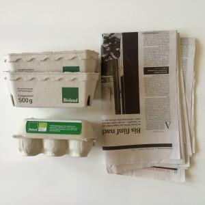 Zeitungspapier und (falls vorhanden) ein wenig Pappe (z.B. Eierkarton)
